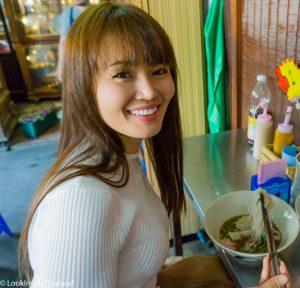 Namfon at a boat noodle soup shop inside Chatuchak Market