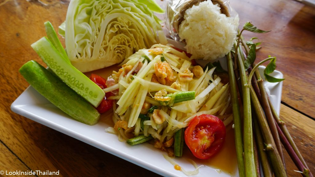 Som Tam Thai papaya salad with cucumber, cabbage and sticky rice on the side
